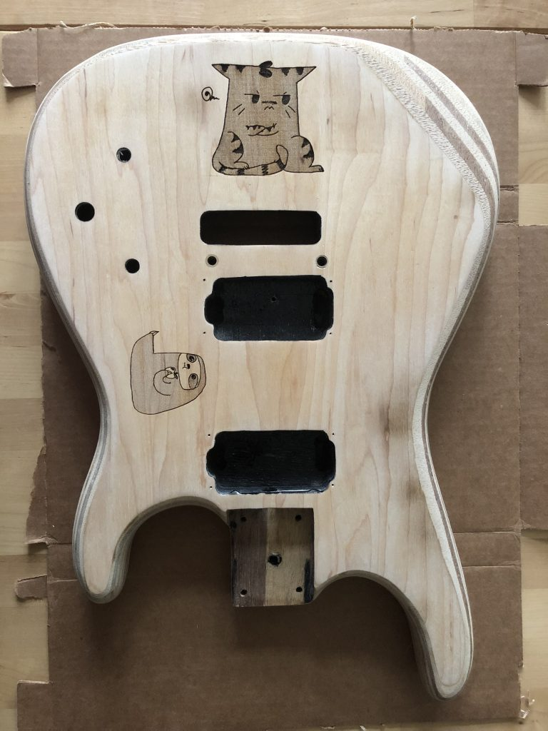 both designs on guitar body